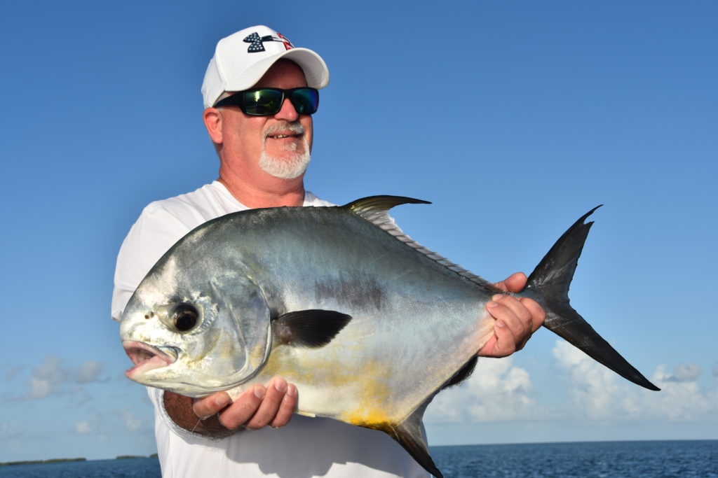 an angler holds a nice permit he caught while sight fishing near key west