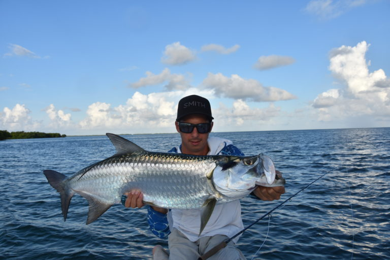 angler Saint Taha holds a nice tarpon he caught with a fly rod in the backcountry off of key west