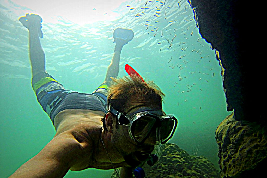 Here is a underwater shot of captain nick snorkeling a coral formation off of key west.