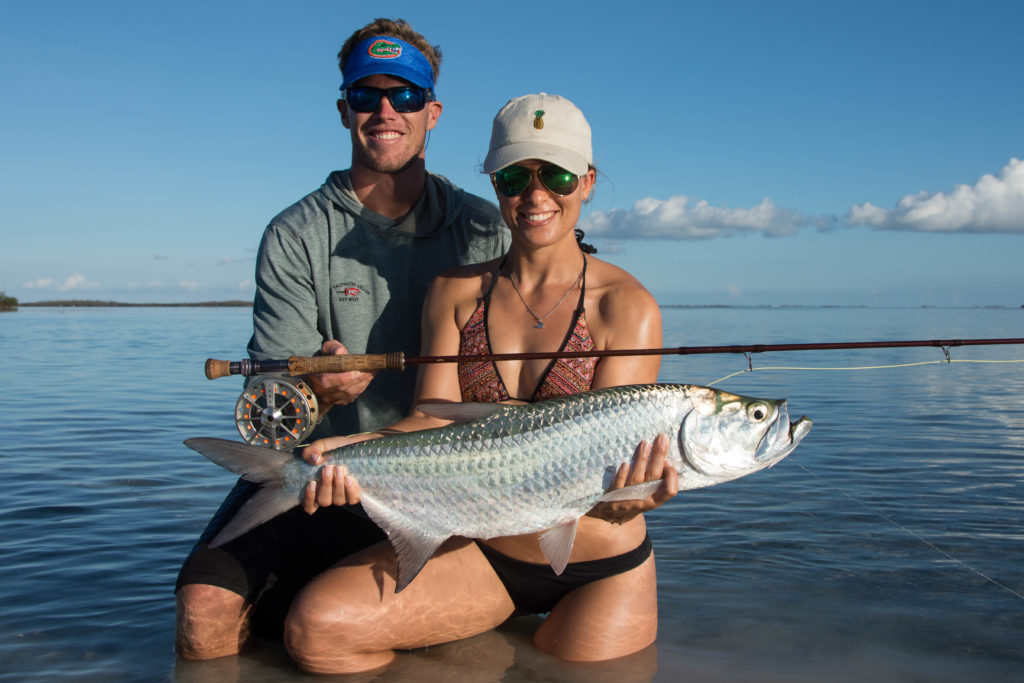 Shawn and Sophie hold a beautiful they caught on fly in the backcountry off of key west