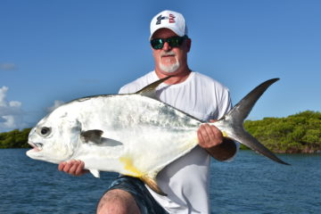 An angler is holding up a beautiful thirty plus pound permit caught in the backcountry off of key west.