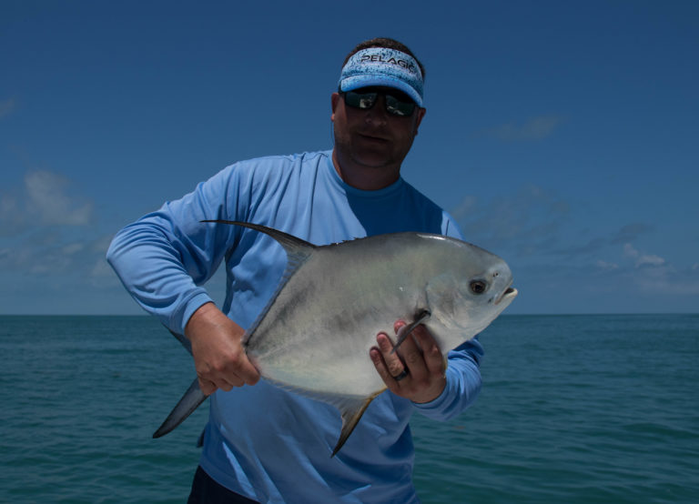 Ashley holds onto a nice permit caught in the backcountry off of Key West.