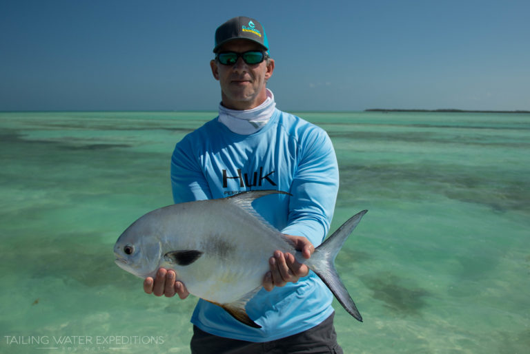 Dave proudly holds a nice permit he sight fished in the flats off of the Lower Keys.