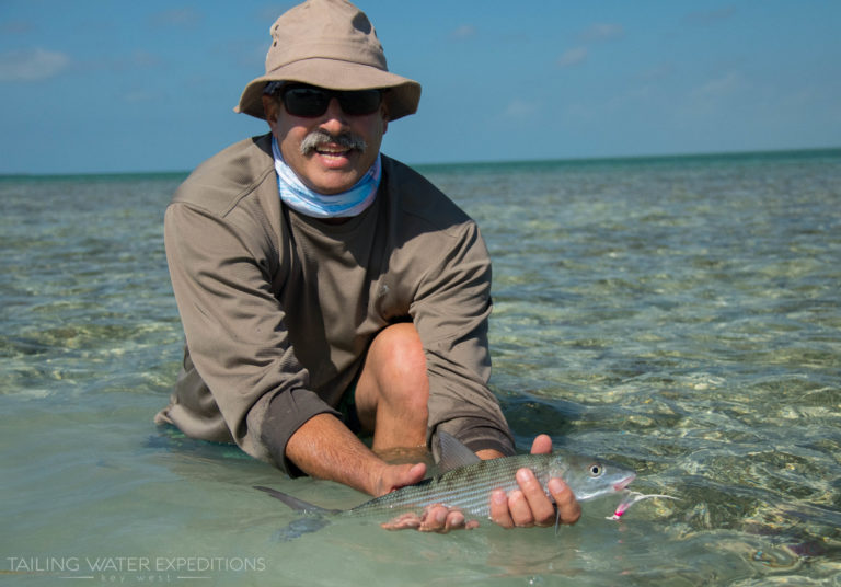 Ray proudly holds up his first bonefish he sight fished off the flats in the Florida Keys