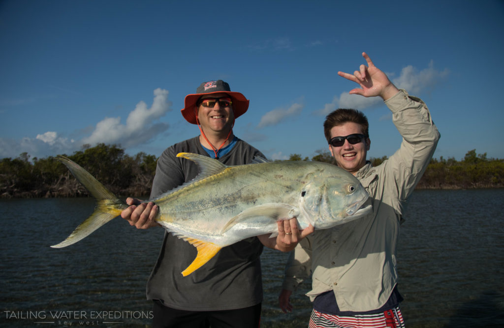 These anglers hold up a monster Jack Crevalle they caught in the backcountry off of Key West