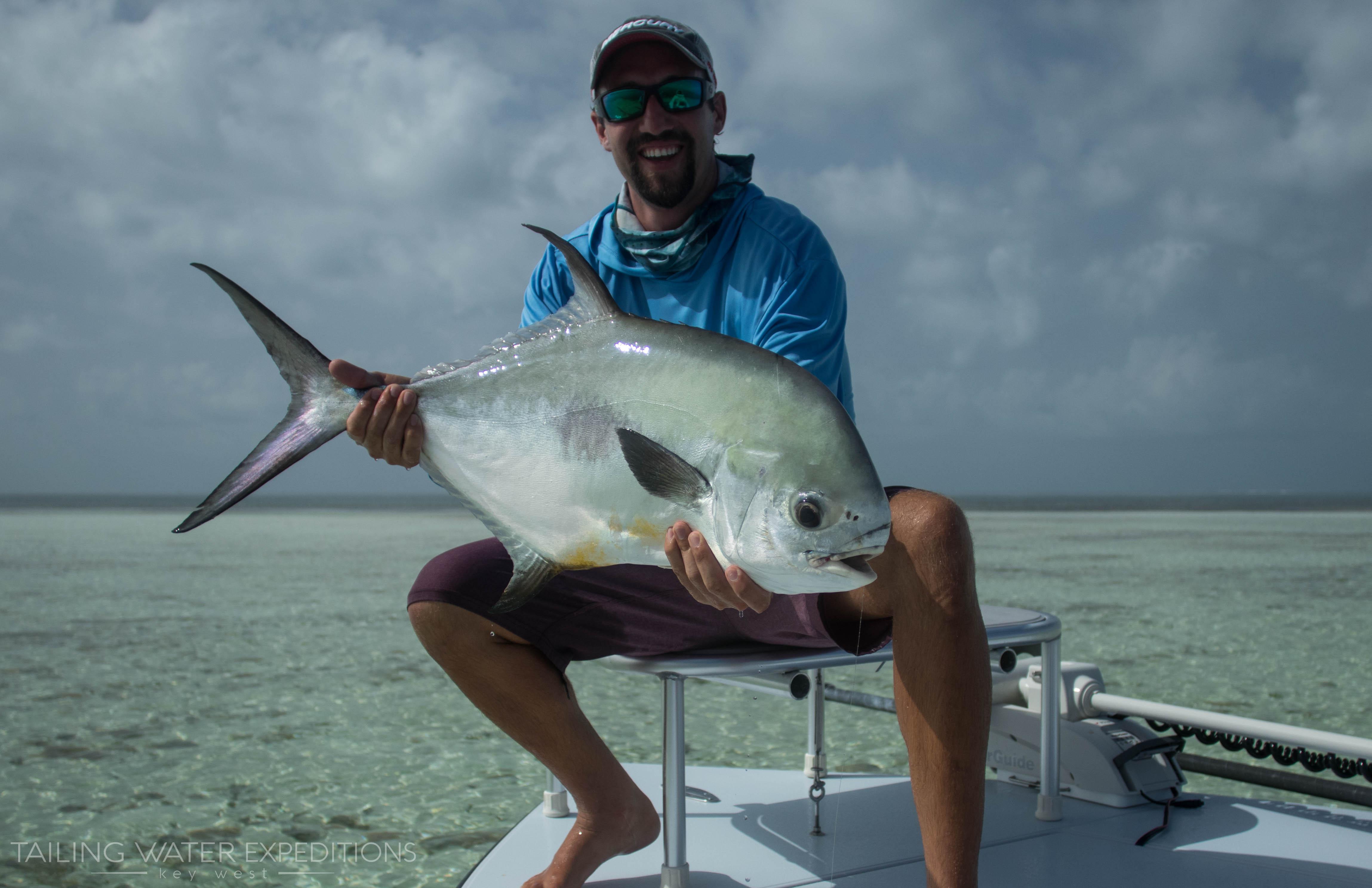 Capt. Nick LaBadie down in Key West Florida holding up a big permit!