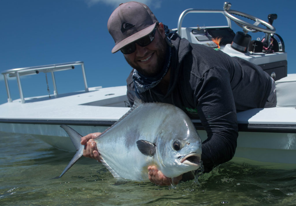 Taylor is holding a nice permit he caught while sight fishing in the Florida Keys