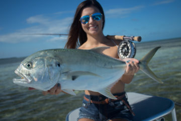 Jessyca holds up a nice jack crevasse caught on fly while fishing the flats in Key West.