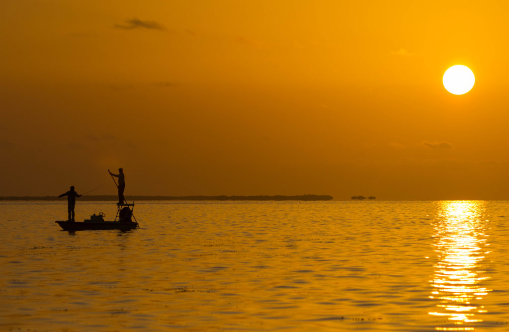 Poling skiff on the flats of Key West looking for tarpon