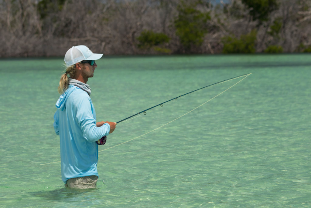 Angler Bryson is trying to fly fish for bonefish over a beautiful sand flat in the Florida Keys